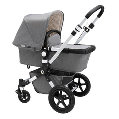 Bugaboo Cameleon 3 Plus (Grey Melange/Aluminium) - quarter view, showing the carrycot and chassis together as the pram