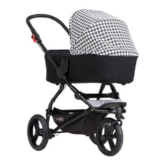 Mountain Buggy Swift - Luxury Collection (Pepita) - quarter view, showing the carrycot and chassis as the pram