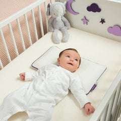 ClevaMama ClevaFoam Baby Pillow - lifestyle image, shown being used in a cot