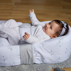 Red Castle Cocoonababy Pod Support Nest (Dreamy Cloud) - showing the Cocoonababy with an infant being held in place by the tummy band