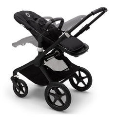 Bugaboo Fox 2 (Black/Black) - quarter view, illustrating the seat in both parent-facing and forward-facing positions