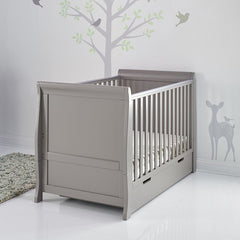 Obaby Stamford Sleigh Cot Bed with Drawer (Taupe Grey) - lifestyle image, shown with cot