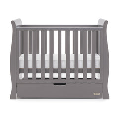 Obaby Stamford Space Saver Cot With SPRUNG Mattress (Taupe Grey) - side view, shown with mattress base at middle level