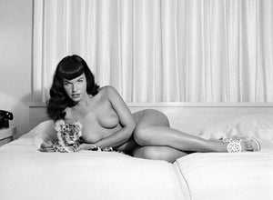 Bettie Page Reclining with Stuffed Animal Print by Bunny Yeager