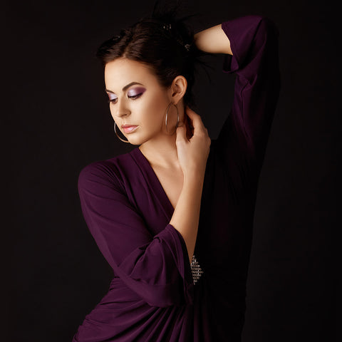 An image of a woman in a magenta dress.