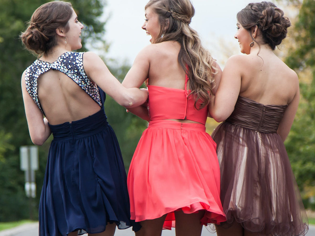 Three wedding guests in colorful dresses.