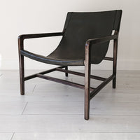 Stacy Leather Sling Chair Black + Black from Souk Collective