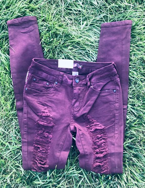 Burgundy Distressed Skinnies