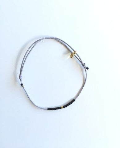 Light Grey Thread and Black/Gold Beads Bracelet