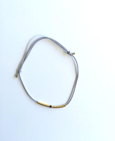 Light Grey Thread and Gold/Black Beads Bracelet