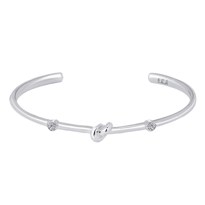 Love Knot Bracelet with White Topaz | Aquamarine  This simple design is handcrafted with Sterling Silver to convey the message of eternal love.  Sterling Silver   White Topaz: 2.5mm  Aquamarine: 2.5mm