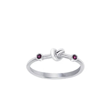 Load image into Gallery viewer, Love Knot Ring with Red Rubies  Handcrafted with Sterling Silver and a Rubies on each side of the Love Knot. As the most elegant of all gems, the energy of the Red Ruby stimulates passion, protection and love for others and oneself.