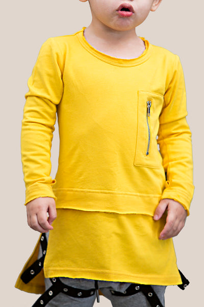 Long sleeve top, featuring a zipper pocket, tall fit , thumb holes, step hem, and side splits.