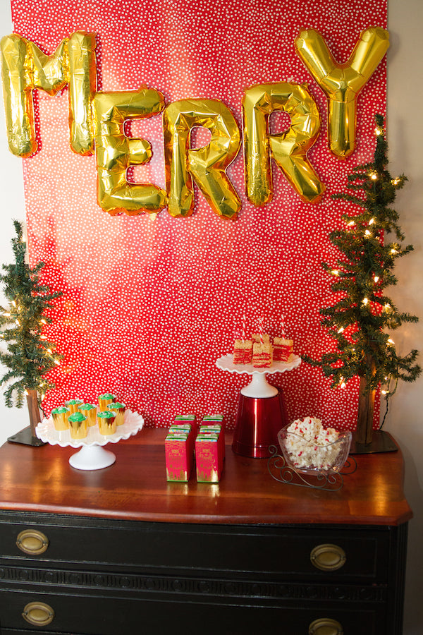 Red and Gold Merry Christmas Dessert Table Shop festive party products now at pinkpoppypartyshoppe.com