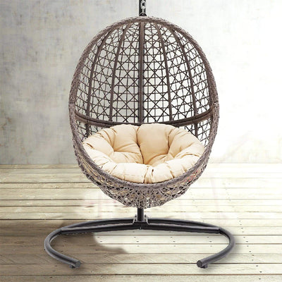 TheraLiving Wicker Hanging Egg Chair Swing with Tan Tufted Cushion and Stand
