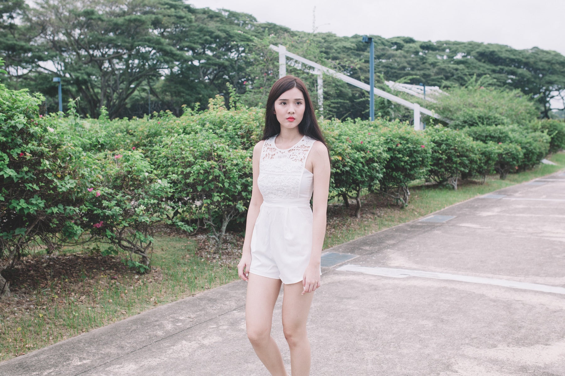 Lace-Paneled Romper in White