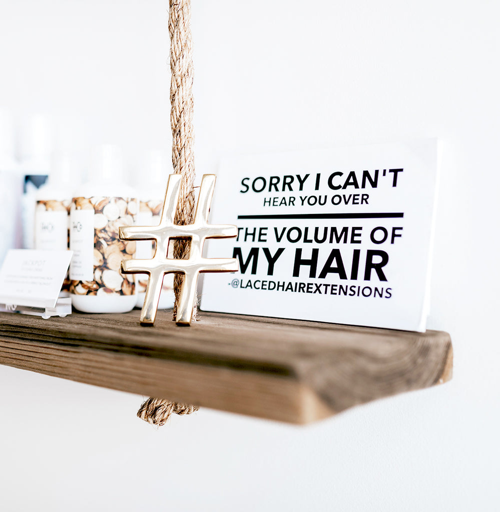 hair saying sign on a hanging shelf in a salon