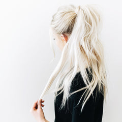 woman with long full ponytail with extensions