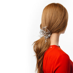 pulled back hairstyle with tinsel