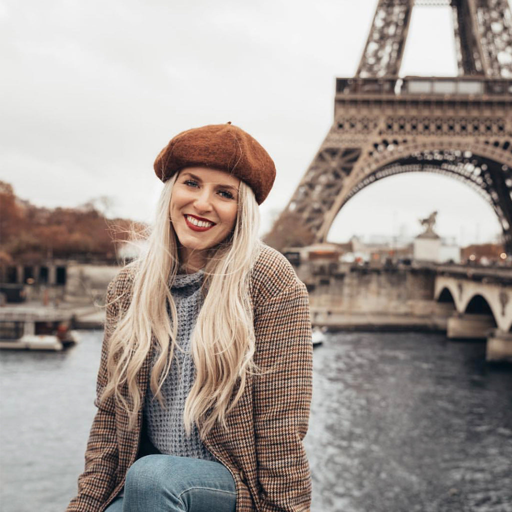 anna with laced hair in front of eiffel tower paris france