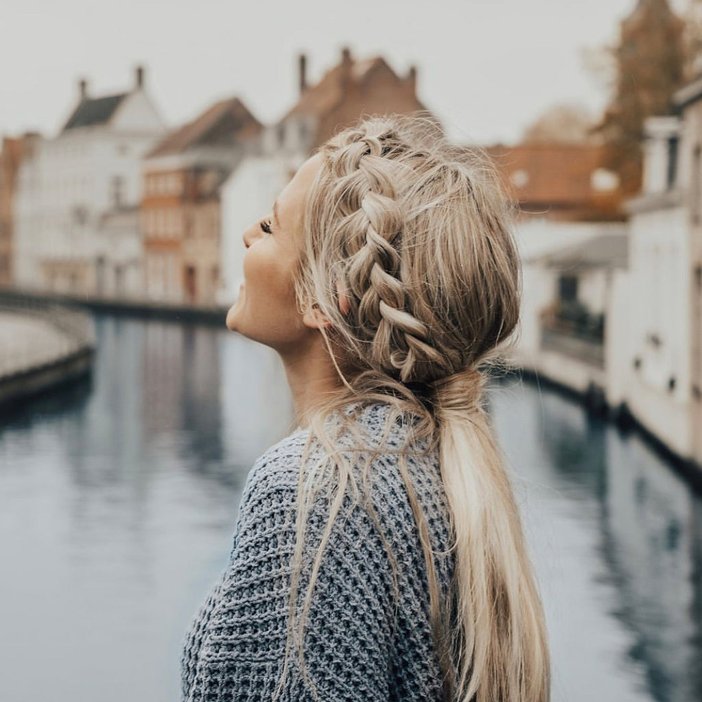 anna with braided hair in brugge belgium