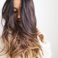 woman with long hair and ombré color