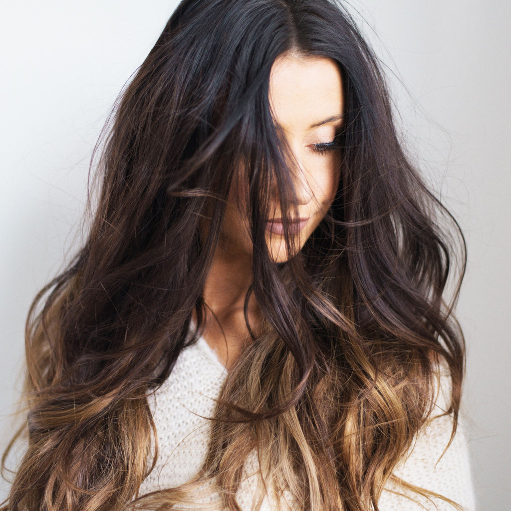 woman with big long brunette hair with lots of volume