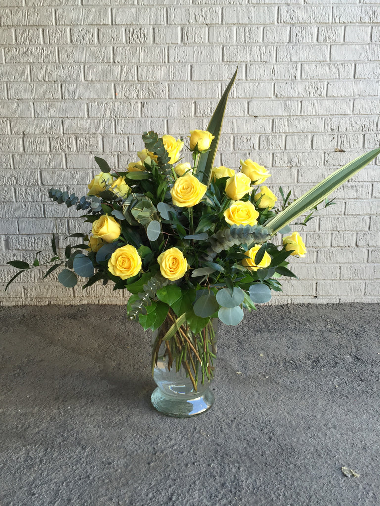 Two Dozen Roses Arranged in a Vase