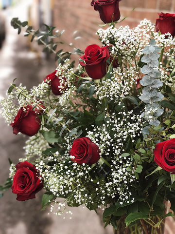 A Classic Dozen Roses Arranged in a Vase