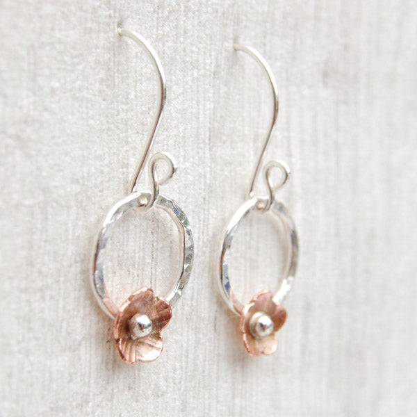 Copper flowers with circles on hooks