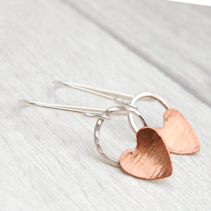 Copper heart and hammered silver circle earrings