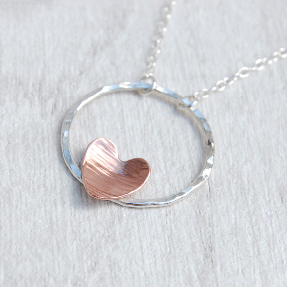 Copper heart on silver circle necklace
