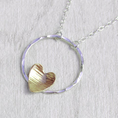 Gold hammered heart on silver circle necklace