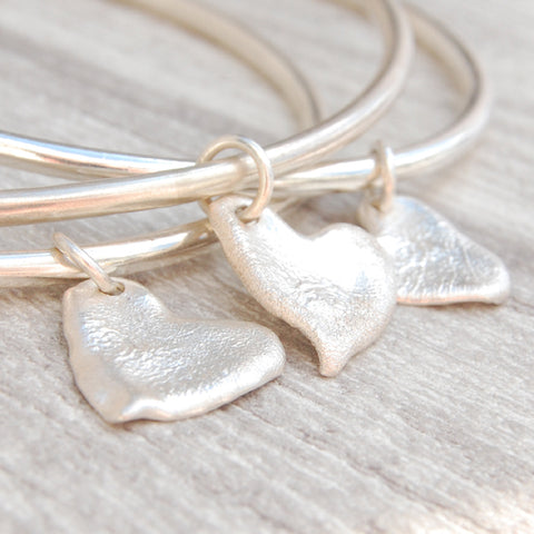 Melted silver heart charm bangle