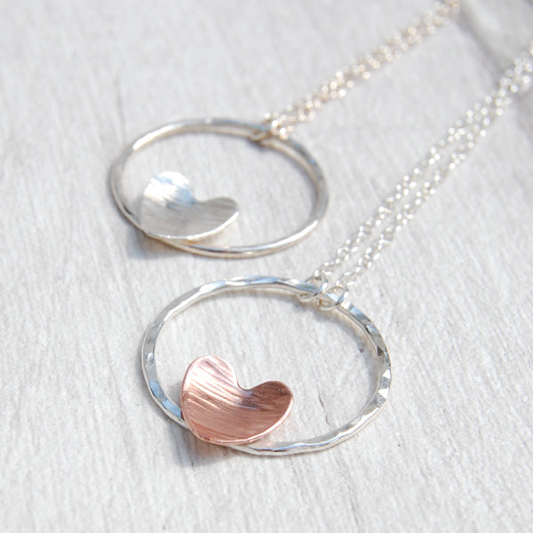 Hammered heart on silver circle necklace