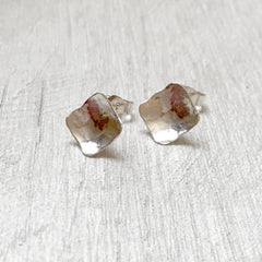 Silver diamond shaped stud earrings