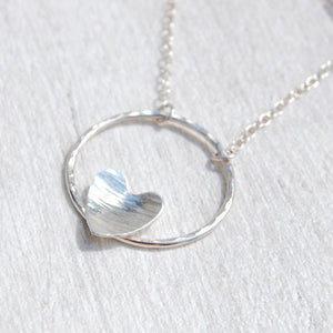 Silver heart on silver circle necklace