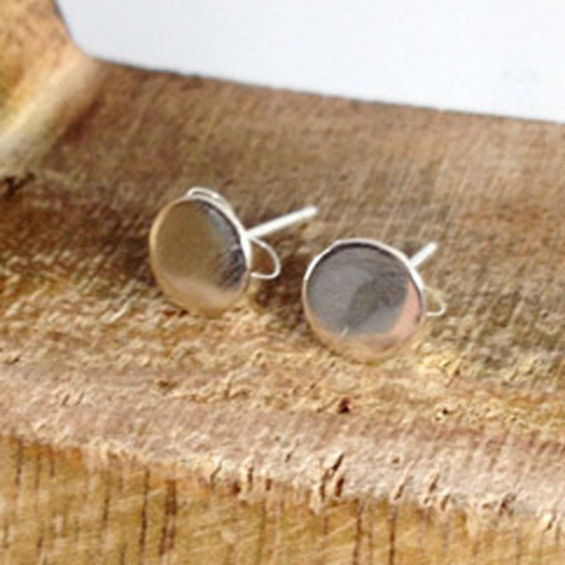 Tiny silver circle stud earrings