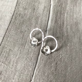 Silver flowers on silver circle studs