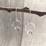 Silver flowers with circles on hooks