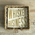 whiskey business napkins in seagrass basket