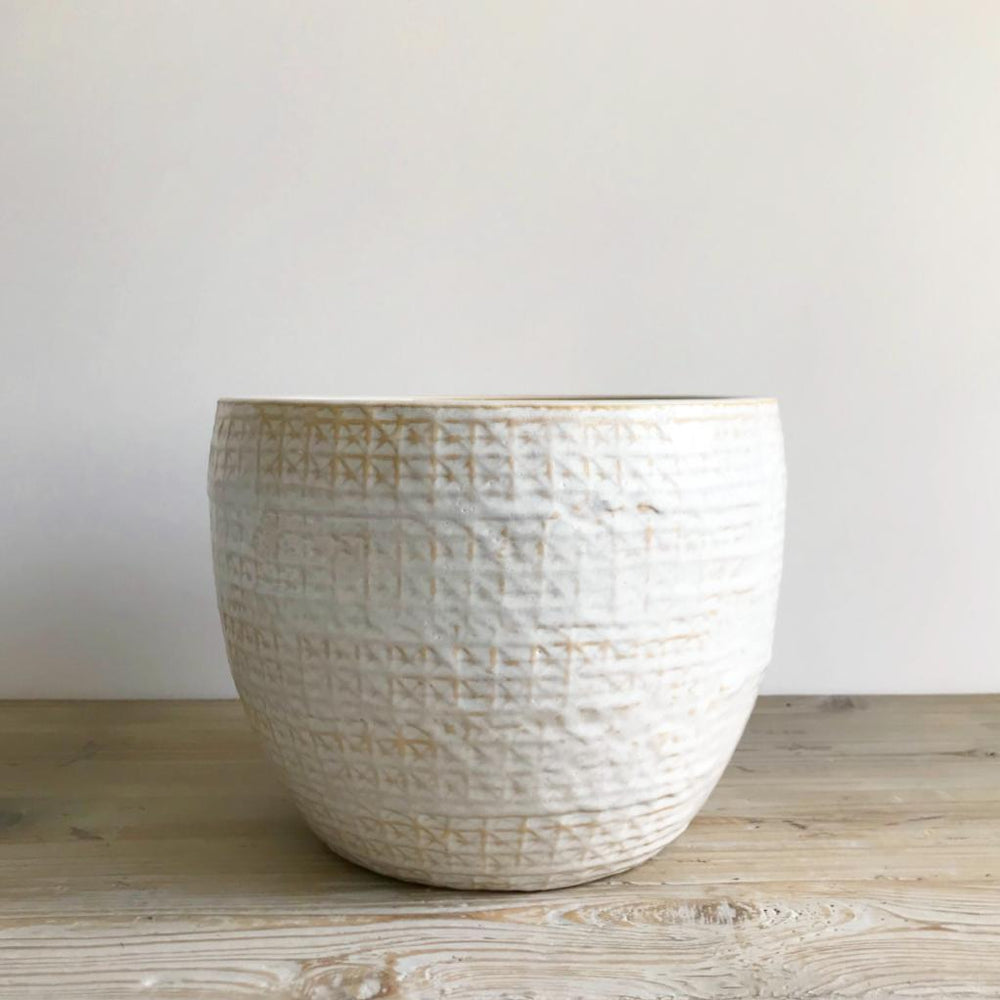 white glazed ceramic pot