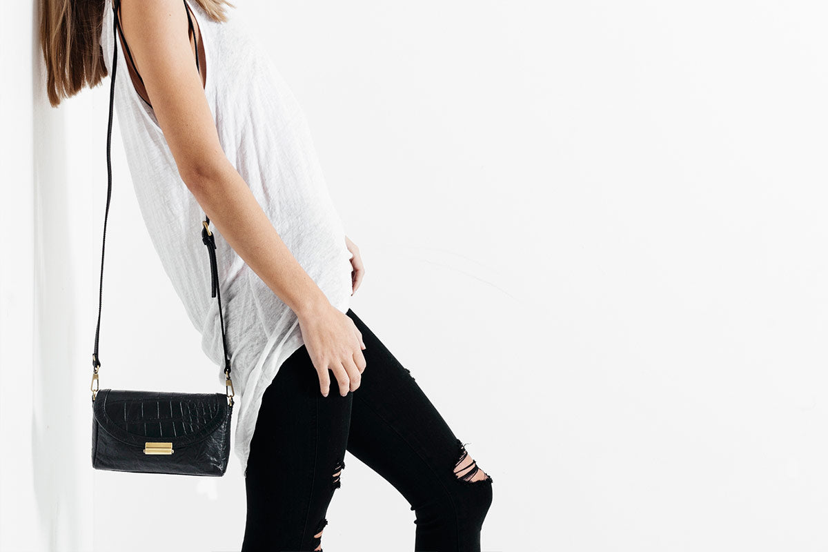 status anxiety leather handbags