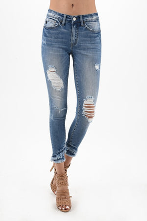 Mid rise distressed jeans with double frayed hem