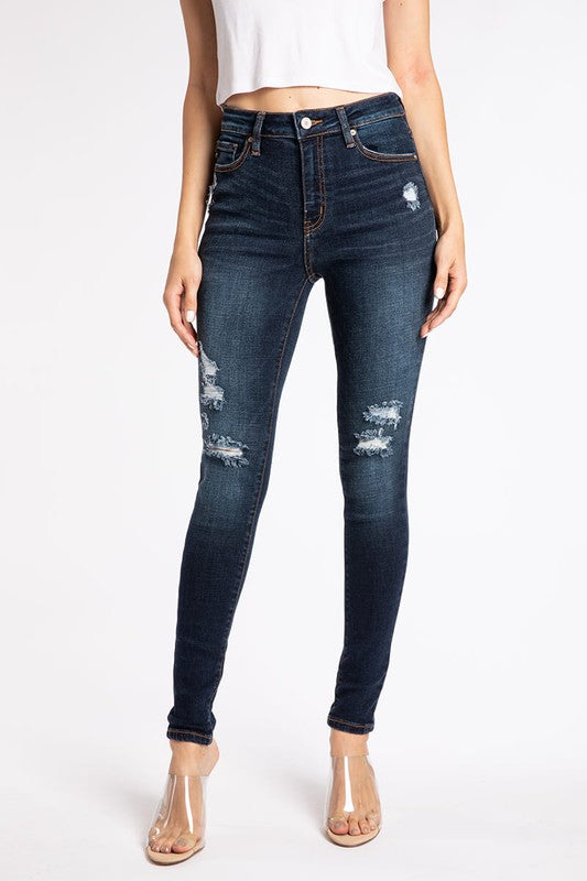 Distressed skinny jeans - mid/high rise