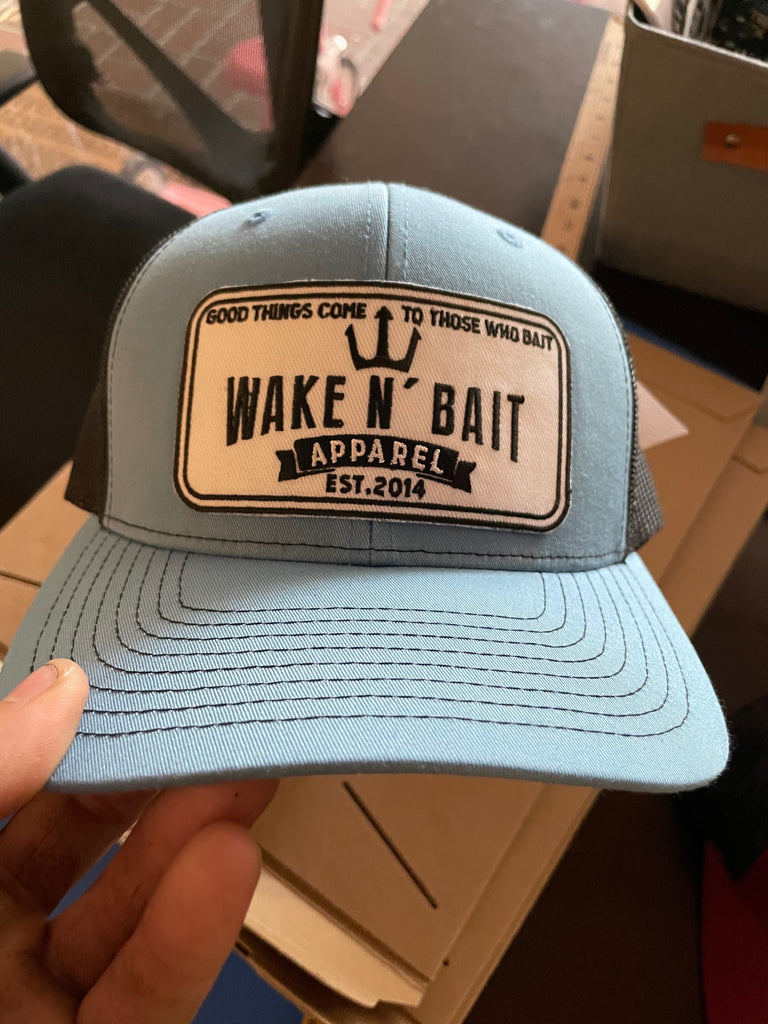 Light Blue and Black Curved Bill Trucker w/ Embroidered Patch