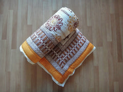 Lotus Garland Quilt~Autumnal Picante Topaz~Rolled View~Hand Block Printed