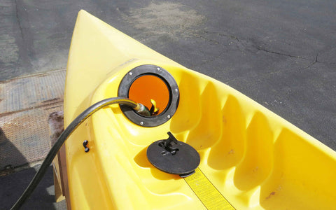 Fill your kayak halfway with water