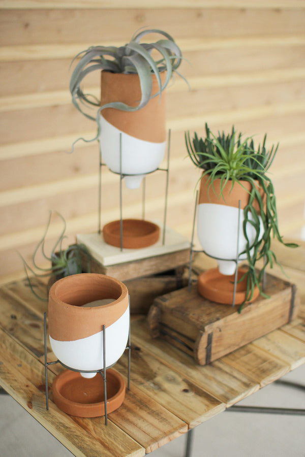 Set of Three Natural and White Clay Pots On Wire Stands