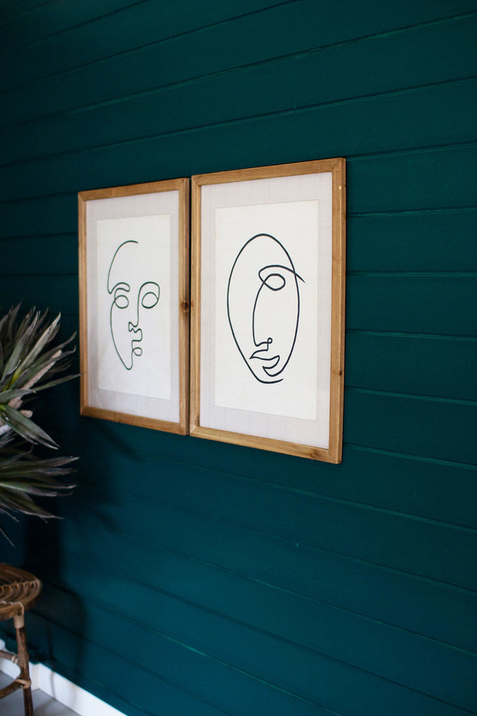 Set of Two Face Prints Under Glass